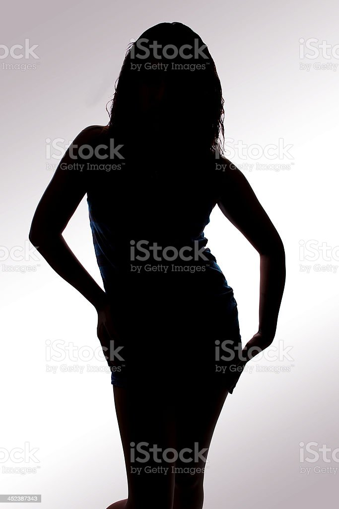 Silhouette of a Female Dancer on Gradient White Background stock photo