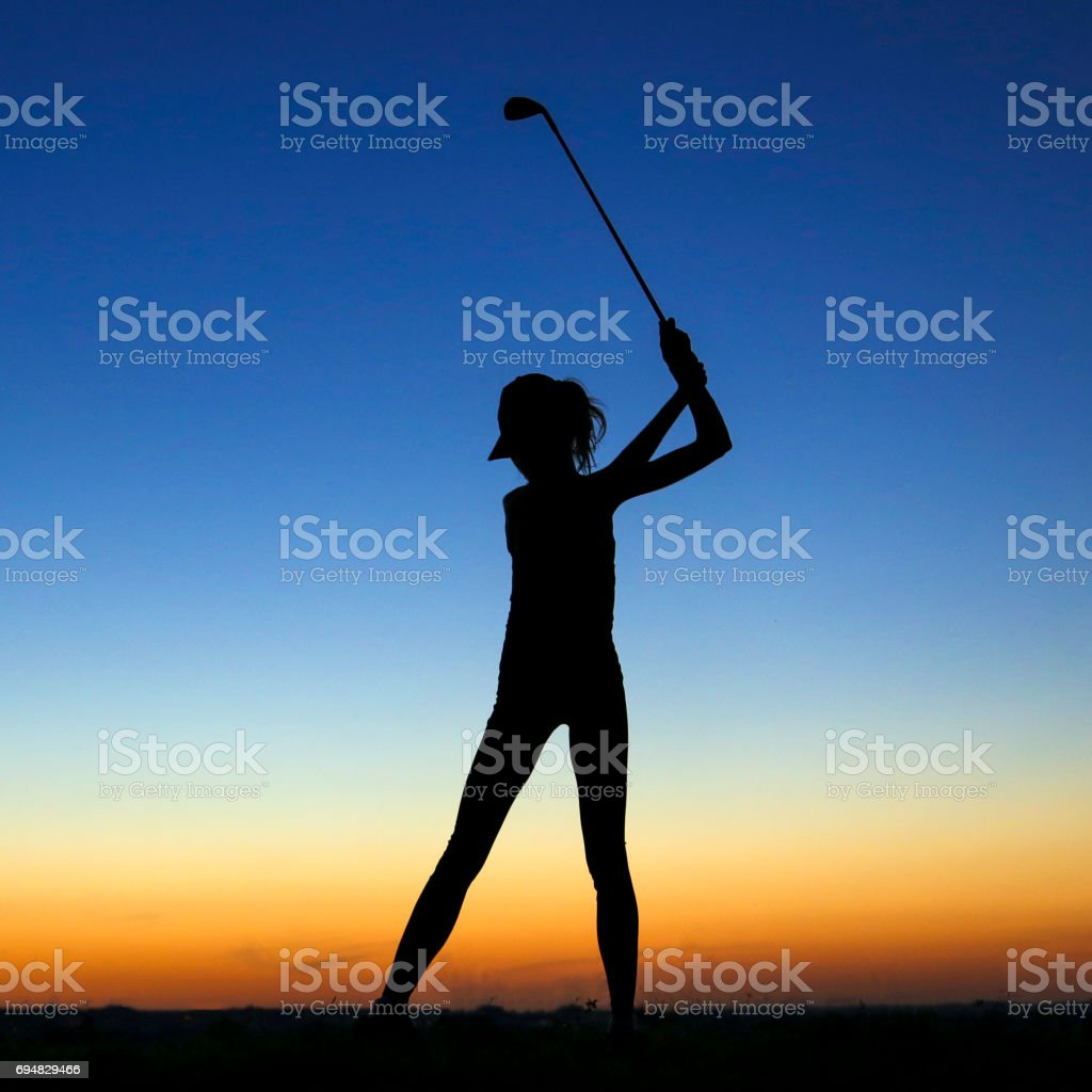 Silhouette of a female golfer stock photo