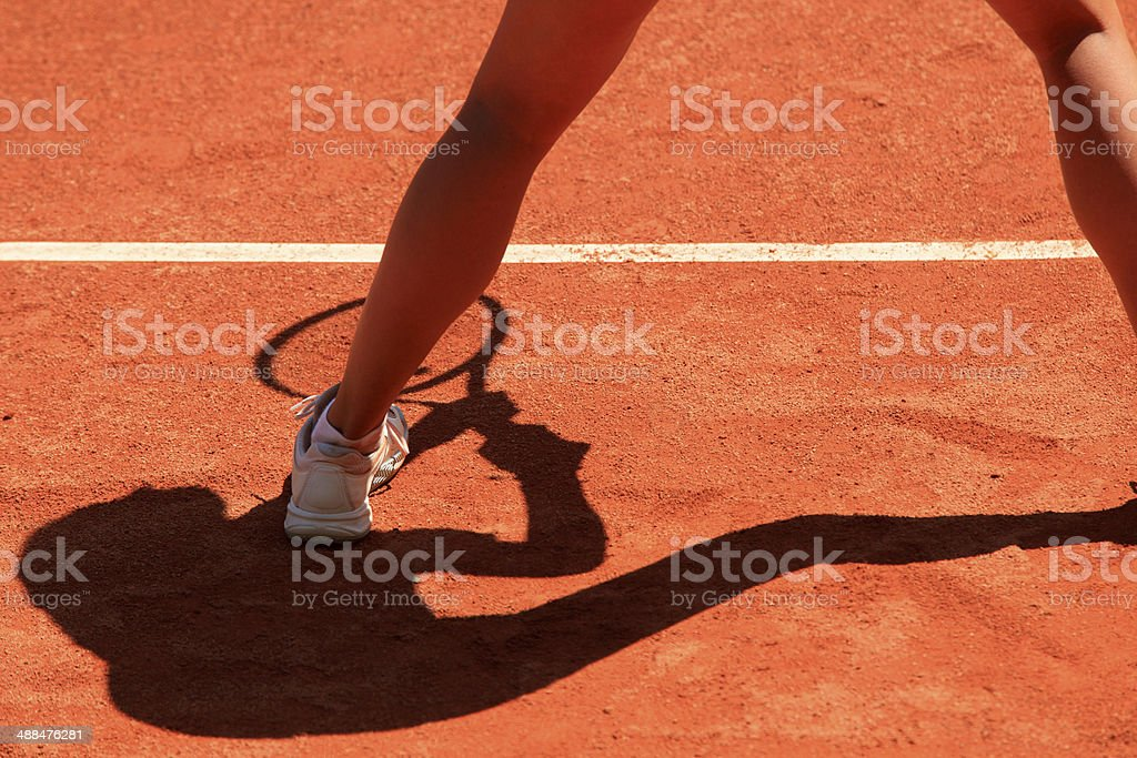 silhouette of a female tennis player stock photo