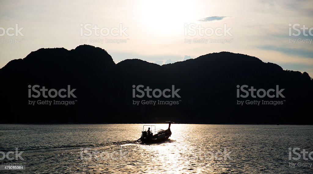 Silhouette of a fisherman and a boat stock photo