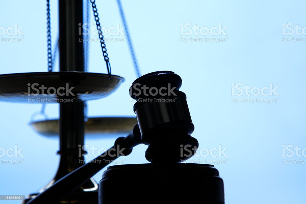 Silhouette Of A Gavel And Scales Of Justice stock photo
