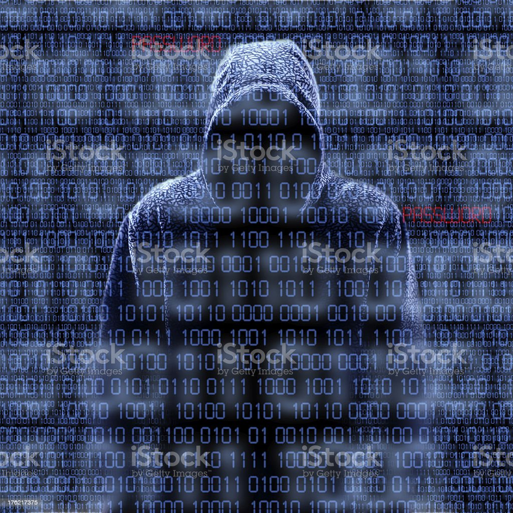 Silhouette of a hacker isloated on black stock photo