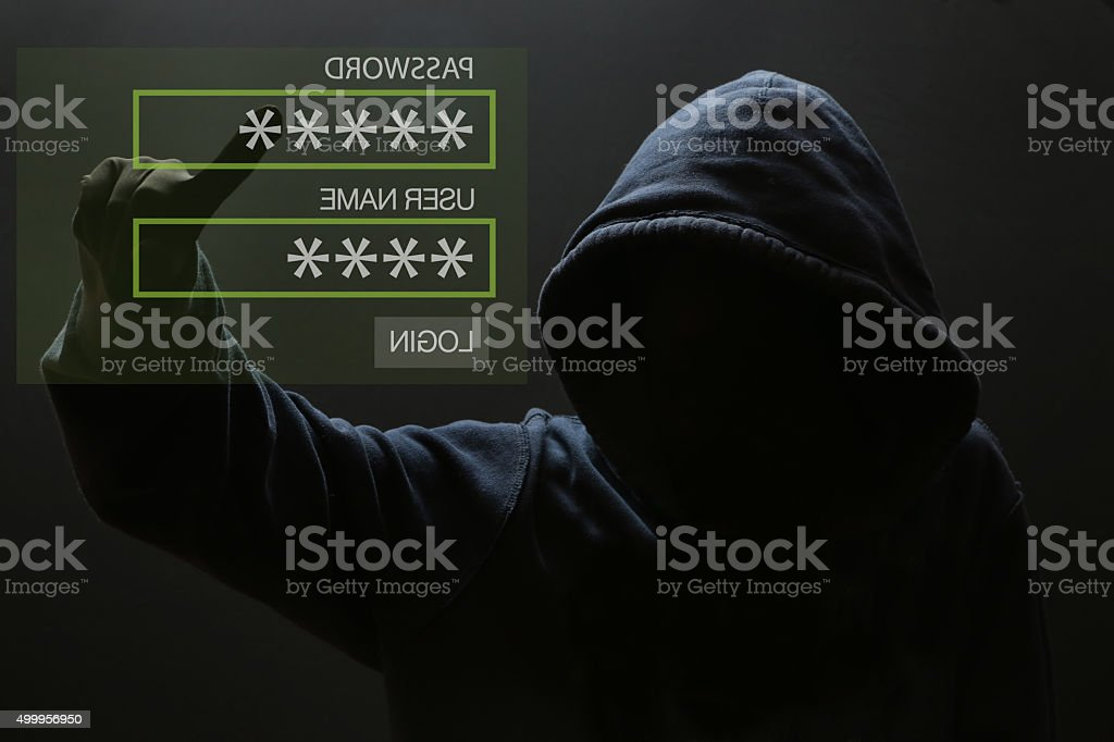 Silhouette of a hacker stock photo