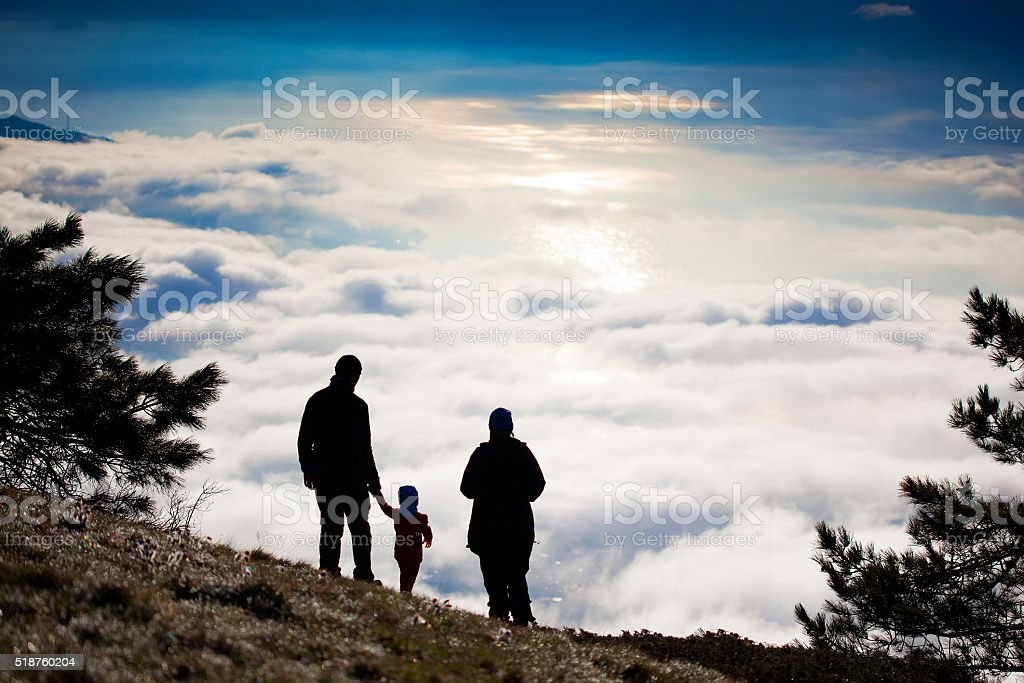 Silhouette of a hiker on top of the mountain stock photo