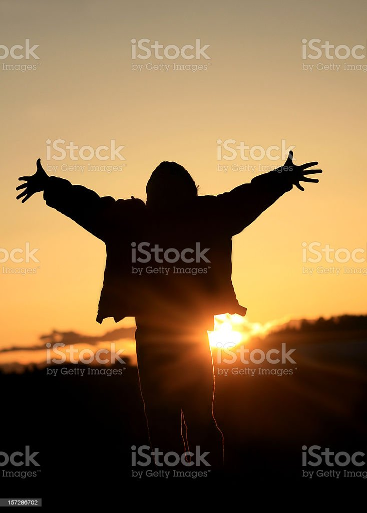 A Silhouette of a Joyful Person stock photo