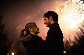 silhouette of a kissing couple in front  huge fireworks