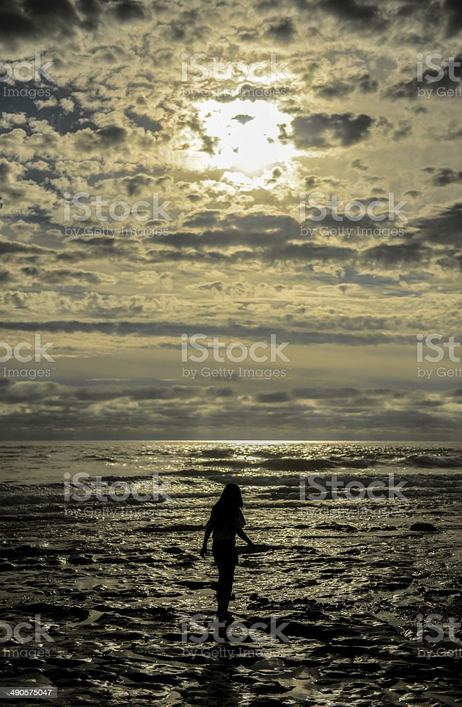 Silhouette of a little girl stock photo