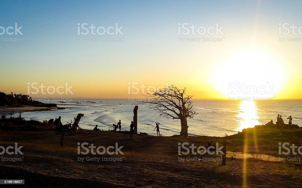 Silhouette of a local boy dancing in Pemba, Mozambique, Africa. stock photo