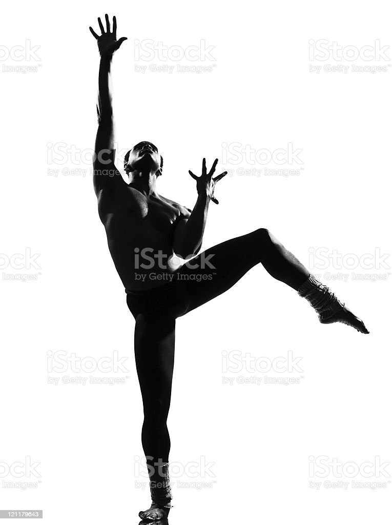 Silhouette of a male dancer with hands outstretched stock photo