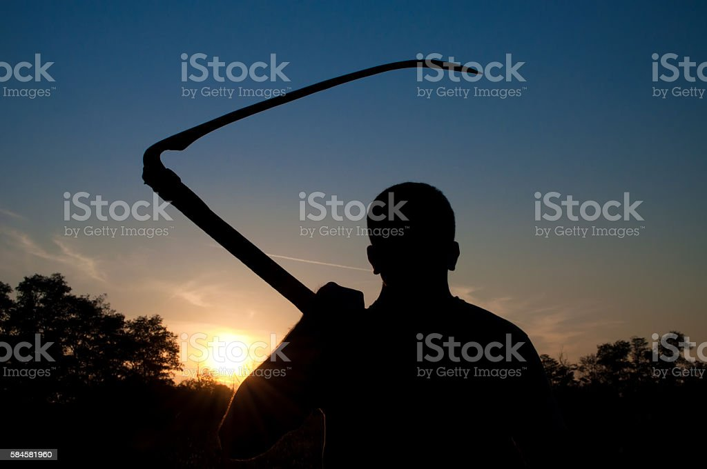 Silhouette of a male person with billhook stock photo