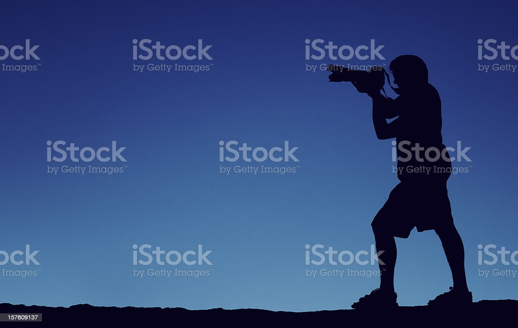 Silhouette of a Male Photographer stock photo