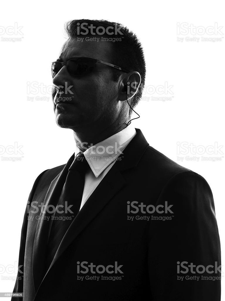 Silhouette of a male secret service agent in a suit stock photo