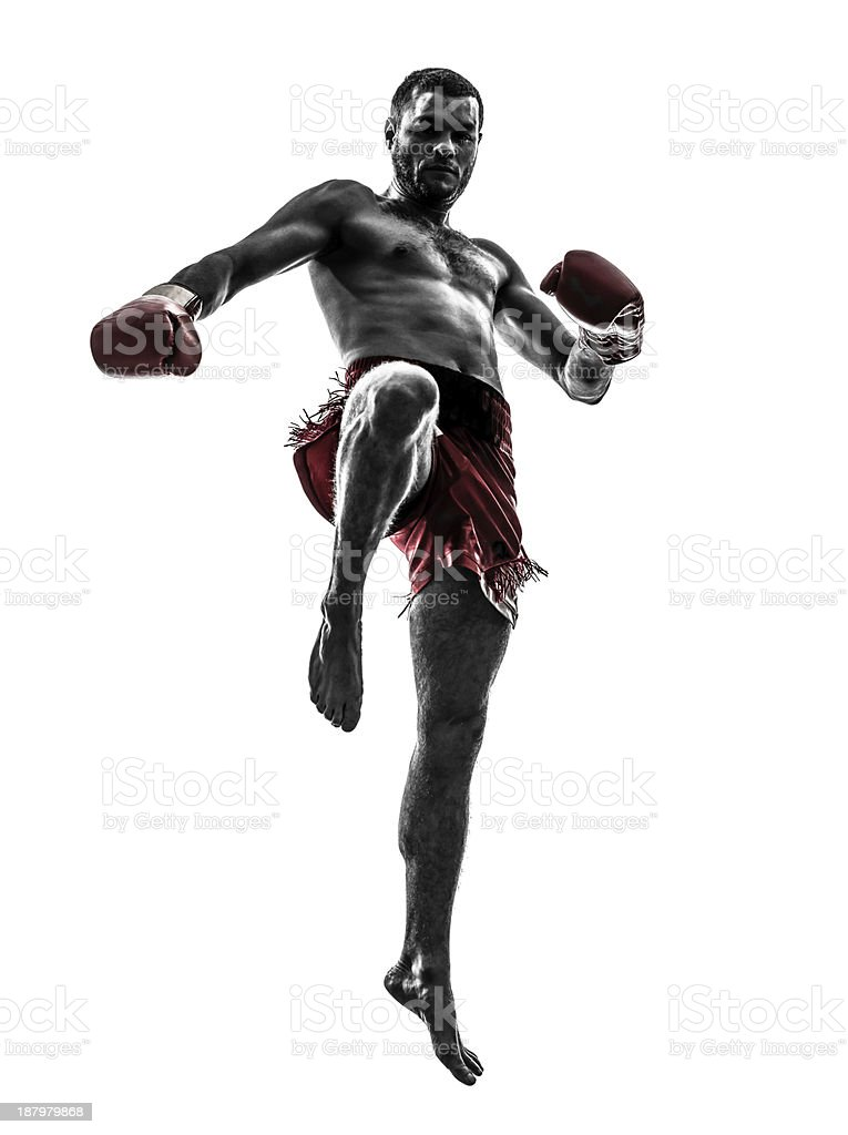 Silhouette of a male Thai boxer exercising stock photo