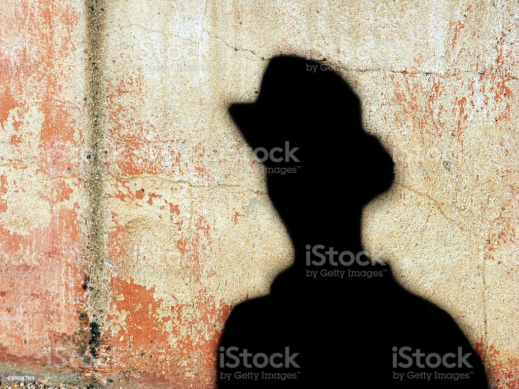 Silhouette of a man against a sandstone wall. royalty-free stock photo