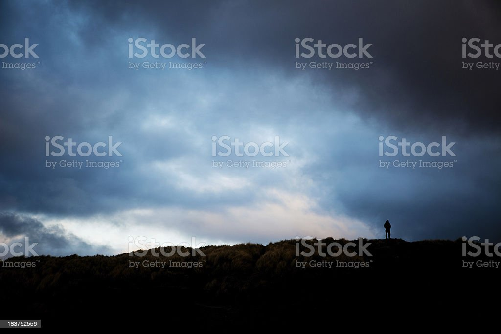 Silhouette of a man during storm royalty-free stock photo