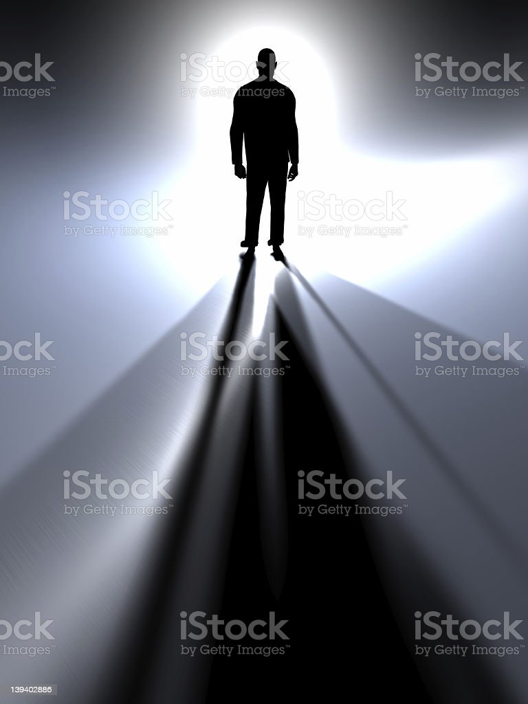 Silhouette of a man in a light at a distance royalty-free stock photo