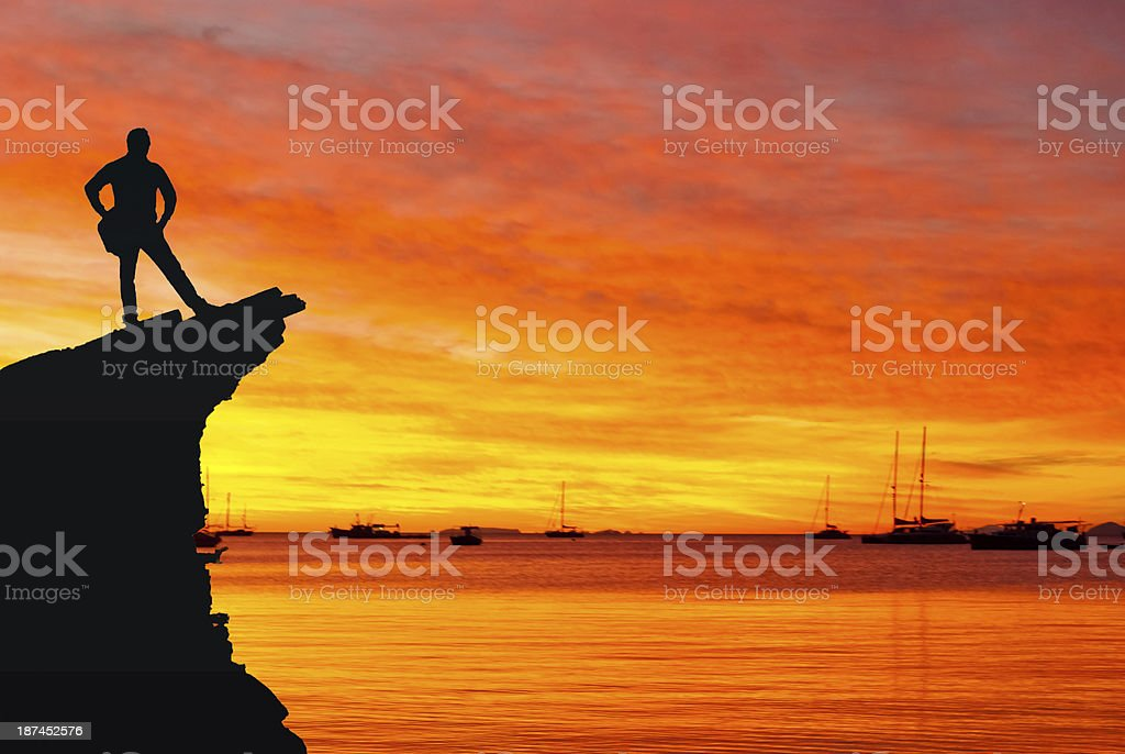 Silhouette of a man looking at the sunset stock photo