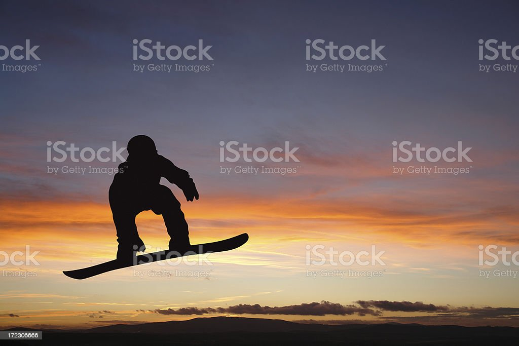 Silhouette of a man on snowboard royalty-free stock photo