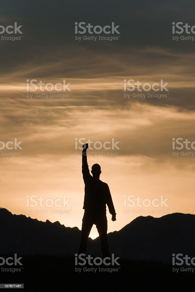Silhouette of a man on the mountain stock photo