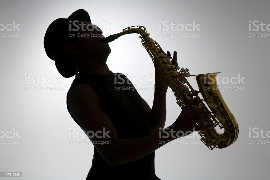 Silhouette of a man playing the saxophone stock photo