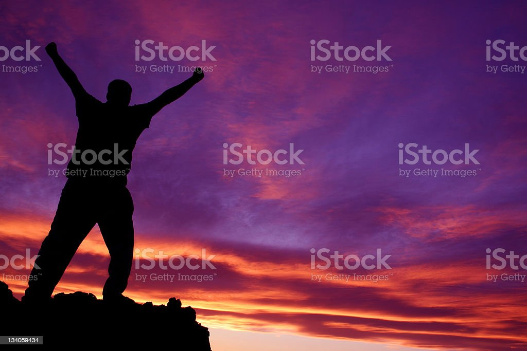 Silhouette of a Man Reaching the Summit of Mountain royalty-free stock photo