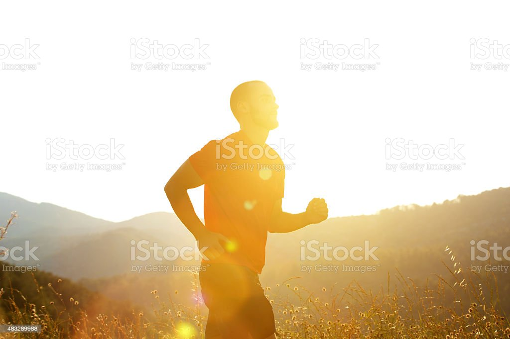 Silhouette of a man running outdoors stock photo