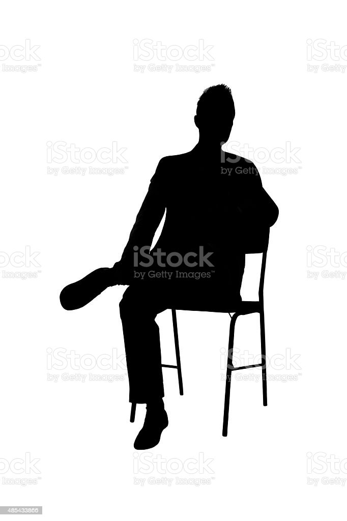 Silhouette of A Man Sitting On A Chair royalty-free stock photo