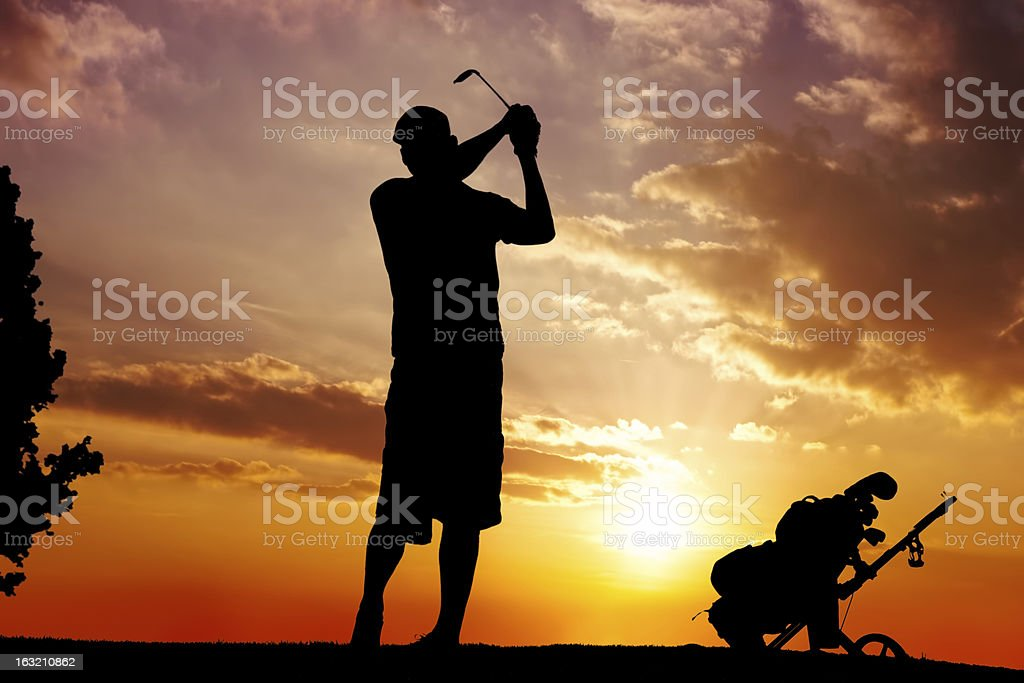 silhouette of a man swinging royalty-free stock photo