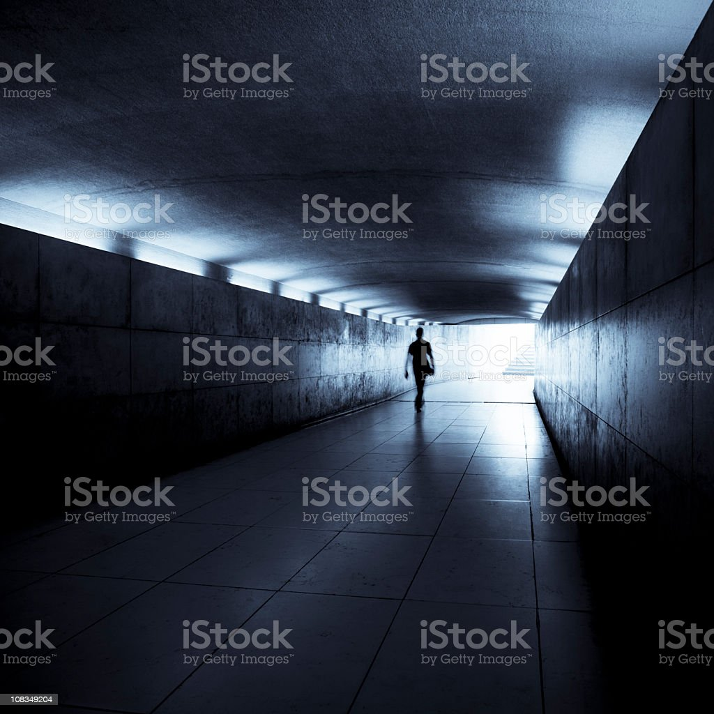 Silhouette of a man walking through a tunnel, Paris, France royalty-free stock photo