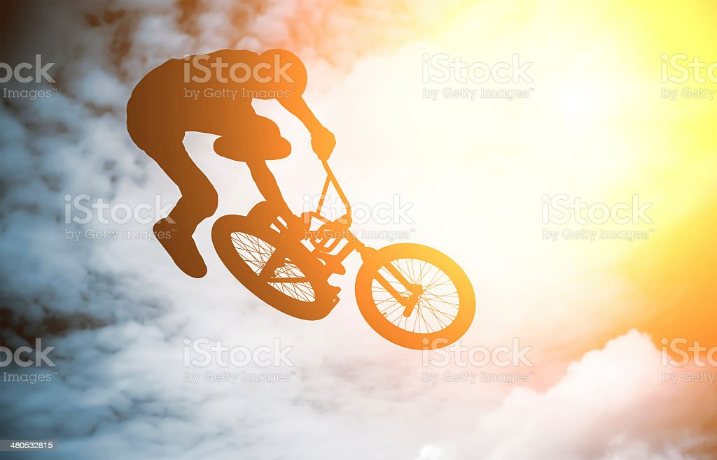 Silhouette of a man with a bmx bike. stock photo
