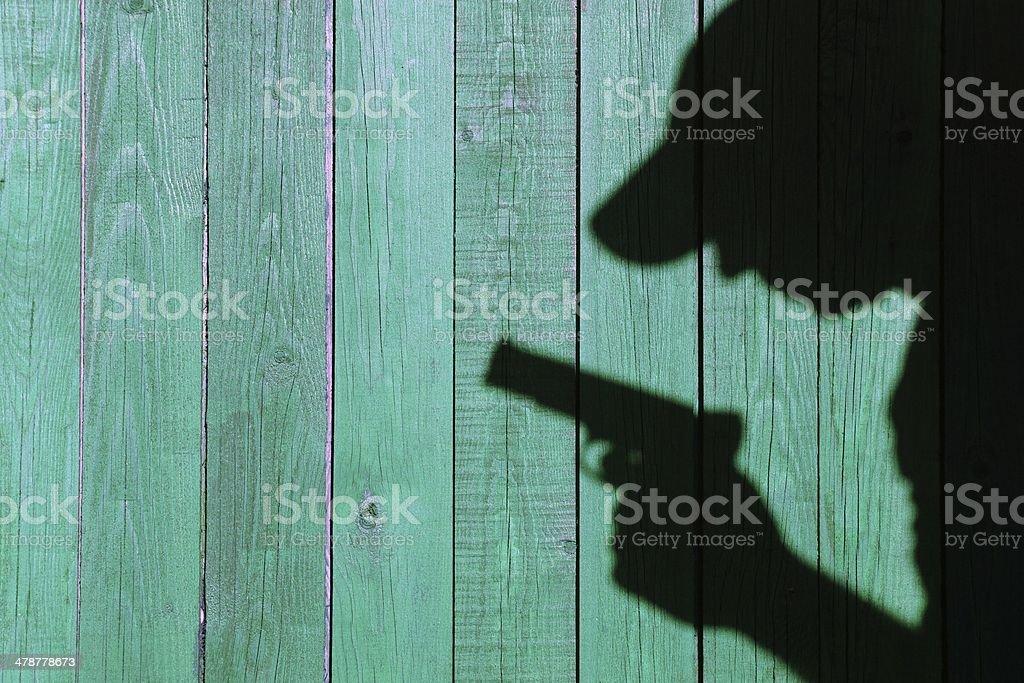 Silhouette of a man with a handgun, XXXL image stock photo