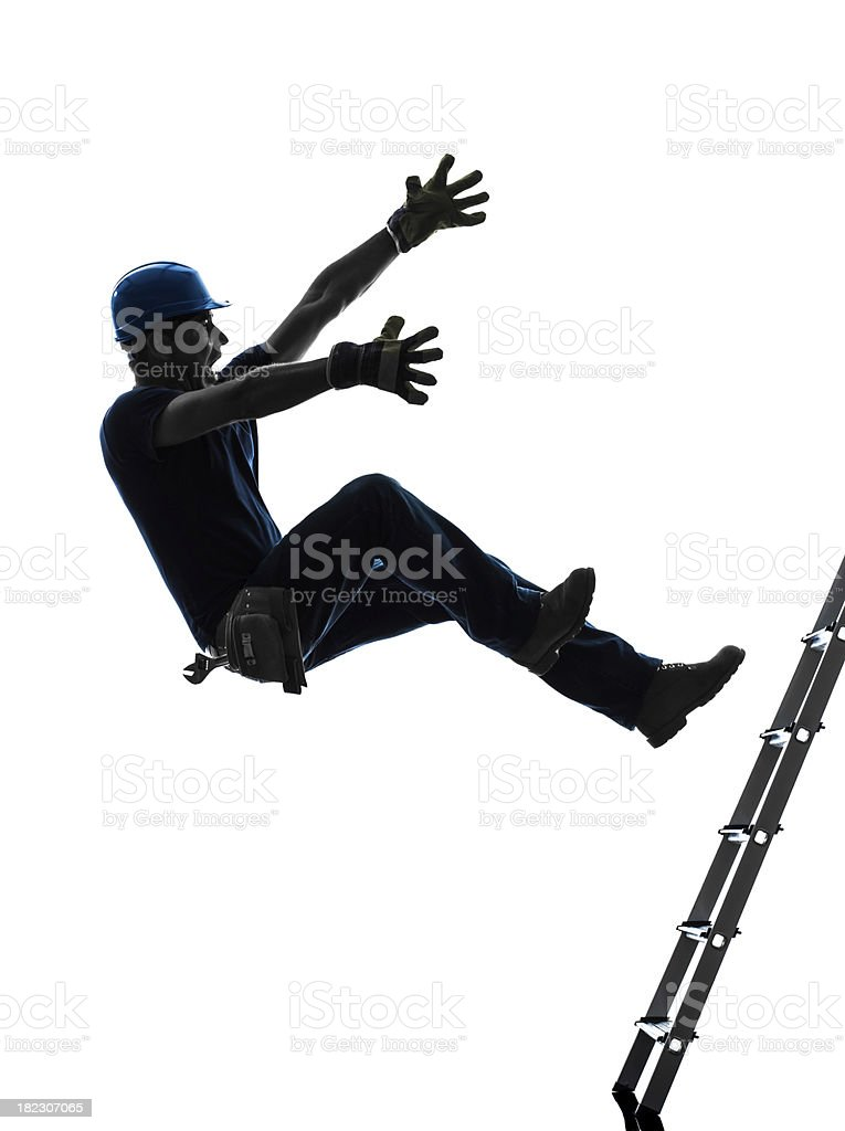 A silhouette of a manual laborer falling from his ladder royalty-free stock photo