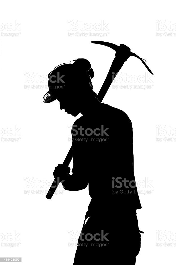 silhouette of a Mine worker with helmet stock photo