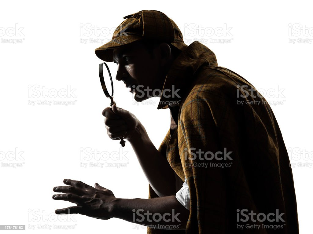A silhouette of a model impersonating Sherlock Holmes stock photo