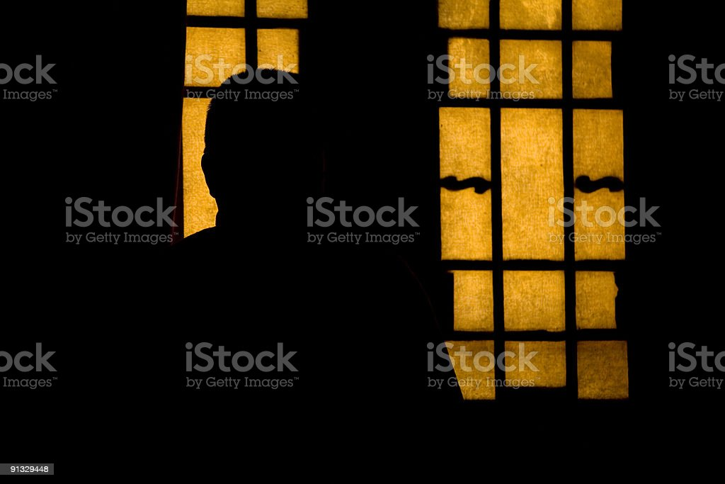Silhouette of a monk royalty-free stock photo