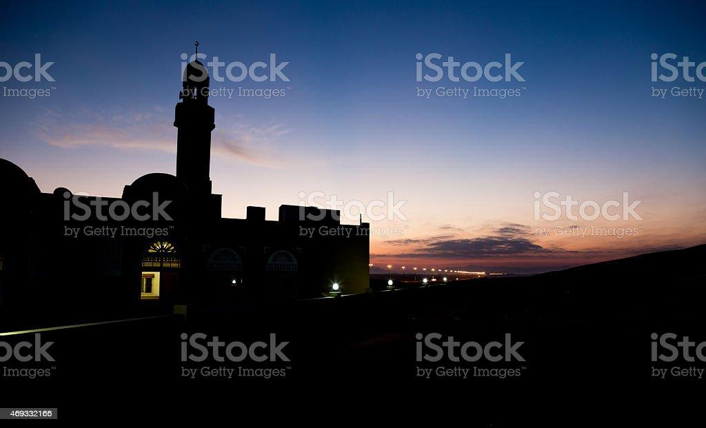 Silhouette of a Mosque at Sunrise in Hatta Desert, Dubai stock photo