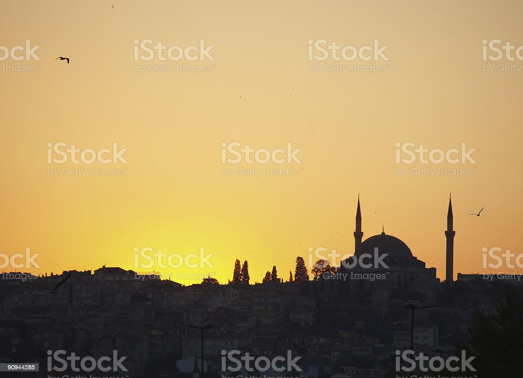 Silhouette of a mosque at sunset royalty-free stock photo