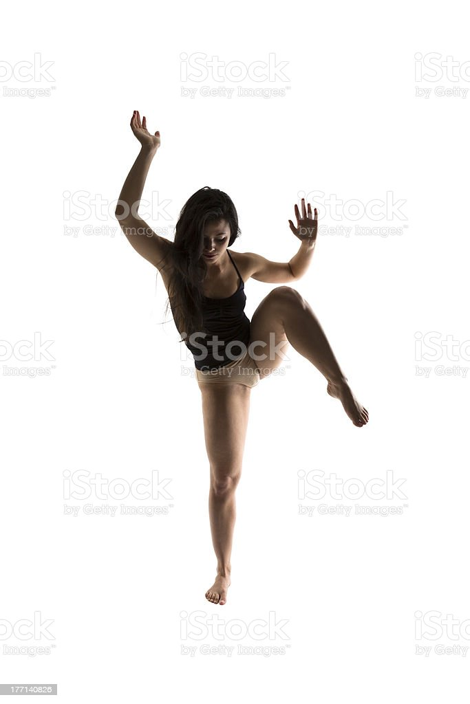 Silhouette of a performing dancer stock photo