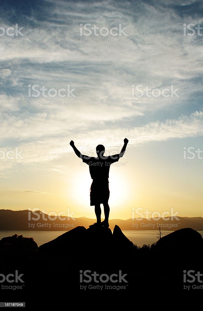 A silhouette of a person at sunset royalty-free stock photo