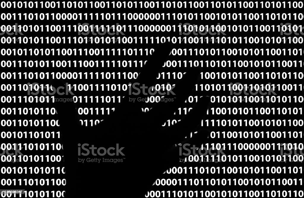 A silhouette of a person's hand through the lines of code stock photo