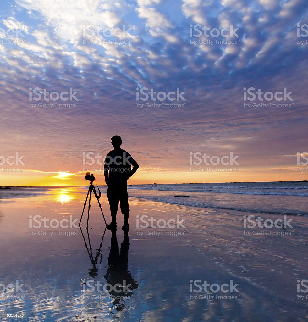 Silhouette of a photographer at sunset stock photo