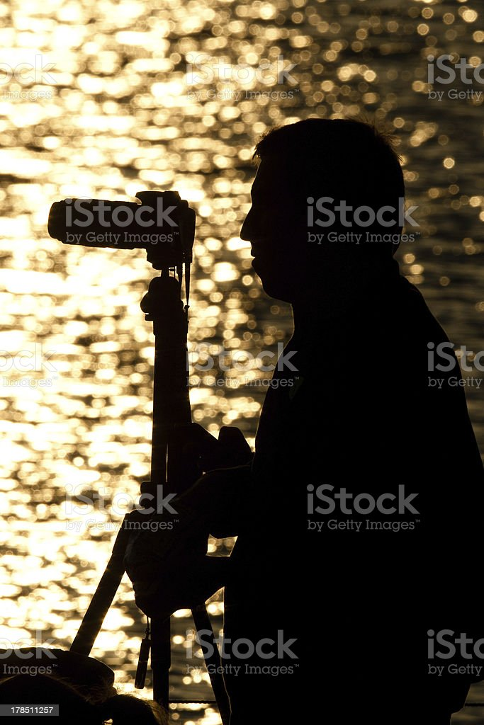 Silhouette of a photographer royalty-free stock photo
