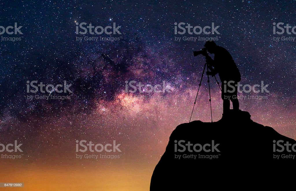 Silhouette of a photographer who shooting a milky way stock photo