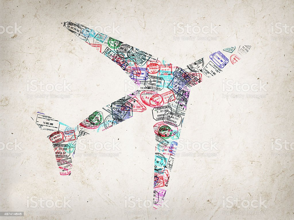 Silhouette of a plane created with passport stamps stock photo