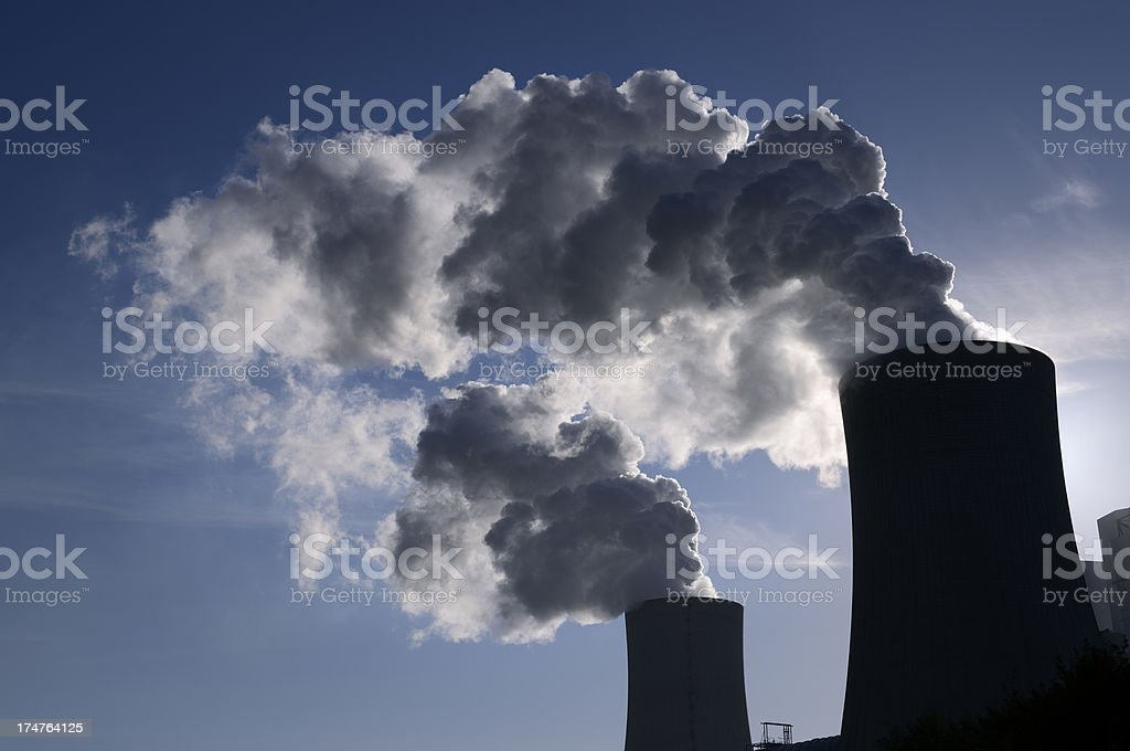 Silhouette of a power plant / cooling towers royalty-free stock photo
