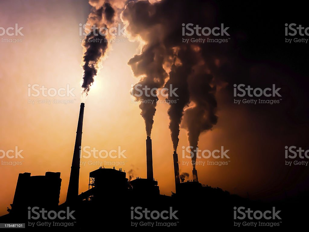 Silhouette of a power plant stock photo