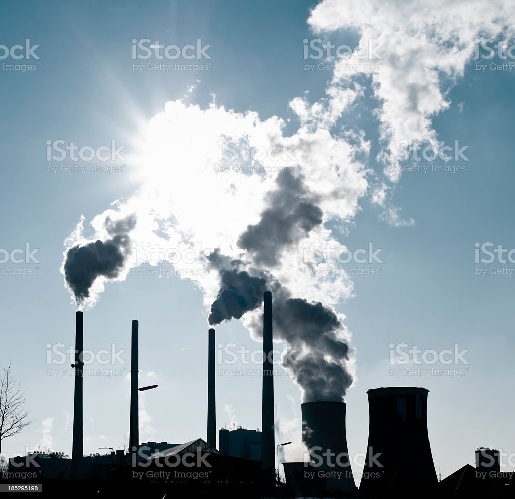 Silhouette of a power plant royalty-free stock photo