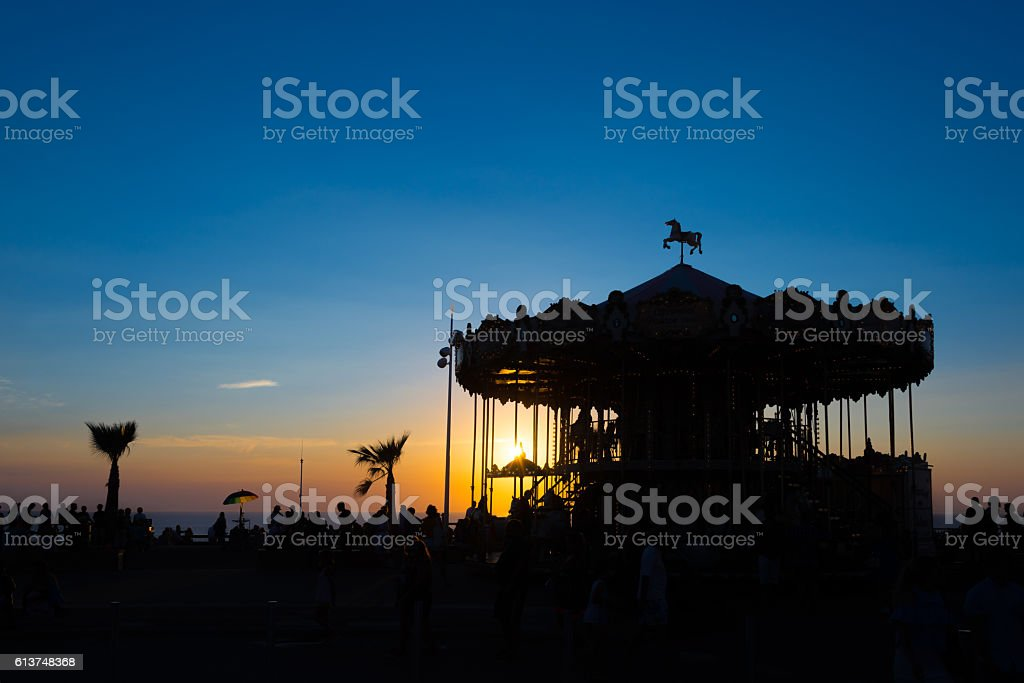 Silhouette of a retro carousel at sunset, Lacanau, France stock photo