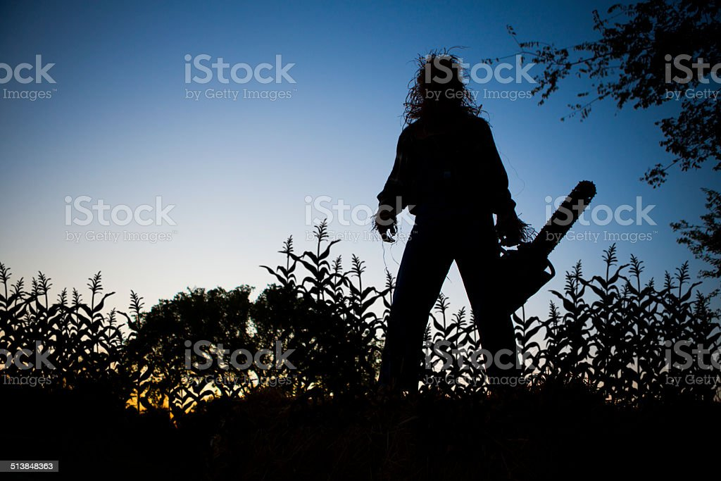 Silhouette of a Scarecrow in cornfield stock photo
