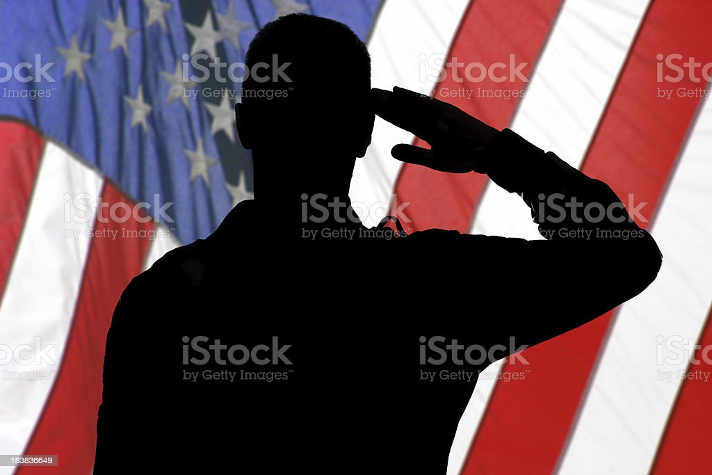 Silhouette of a soldier saluting to American flag royalty-free stock photo